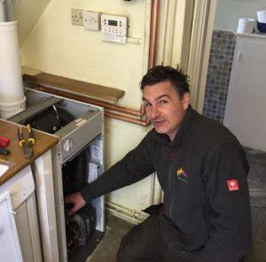 Technician Installing Oil Boiler