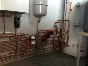 A large luxury property in Hindhead with a twin boiler system, unvented cylinder and water booster set - All in 4 days work for Buxton Heating.